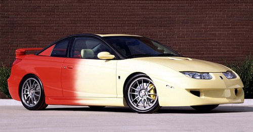 With Its Turbocharged Engine And Sizzling Yellow To Red Paint Scheme The Saturn Scx Three Door Coupe Ignited Pion Of Performance Car Enthusiasts