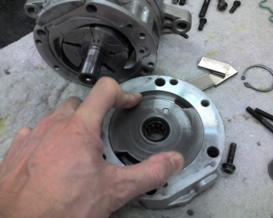 cam plate turned ccw against spring loaded shaft