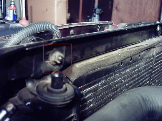 Showing the location of the top radiator bolts